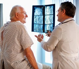 Doctor shows patient CT scans