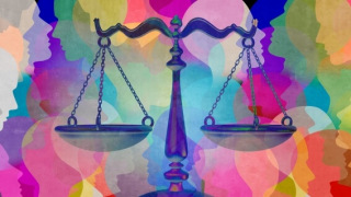 Scales of justice over multicolored faces