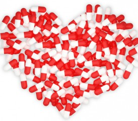 Heart made of red and white pills