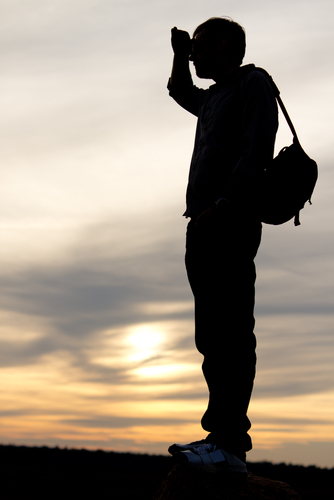 Man Looking Into the Sunset
