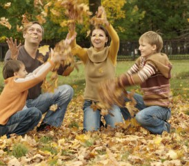 Family Playing in Fall Leaves