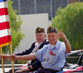 U.S military veterans riding in the back of a car
