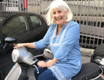 Sissy Hoffman on a scooter in Italy