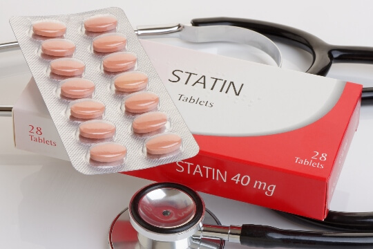 pills with statin box and stethoscope