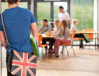 Student with a bag showing UK Union Jack