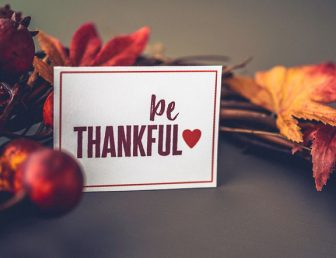 Fall leaves background with wreath and message for Thanksgiving