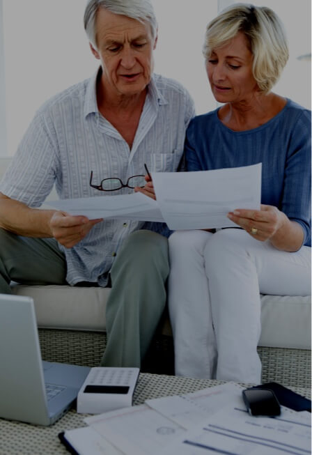 Couple discussing details of a report together