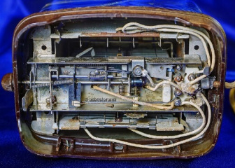 Underside of toaster with asbestos wiring