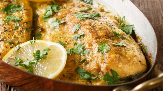 Baked trout with lemon in a pan