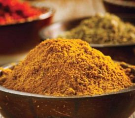 Powdered turmeric in a bowl