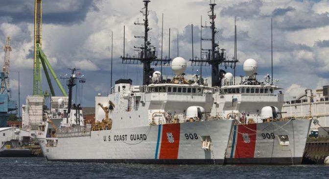 Two Coast Guard vessels tied up at the Portsmouth, NH Shipyard.