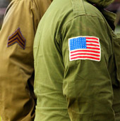 Side of two U.S. military uniforms from World War II (WWII).