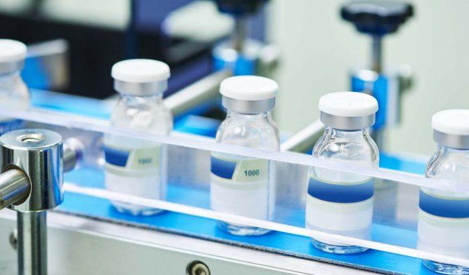 Drug vials in assembly line