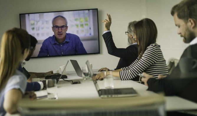 Lawyers virtually meeting with client