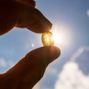 Vitamin D capsule held up to the sun