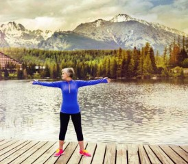 Woman exercising near a lake