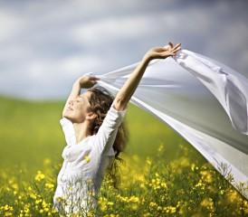 Woman Running Across a Flower Field