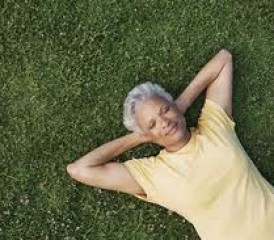 Woman relaxing on a patch of grassy