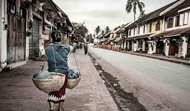 Woman walking in Laos