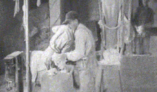 Johns-Manville worker handling asbestos
