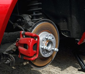Red brake pads on a car