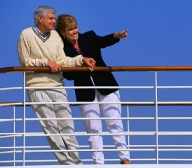 Happy older couple on cruise deck