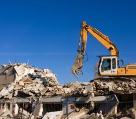 Tractor demolishing a building