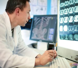 Male doctor looking at X-ray scans