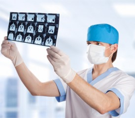 Male doctor examines X-rays