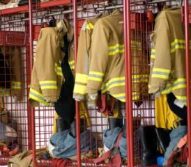 Firefighter jackets hanging in a locker