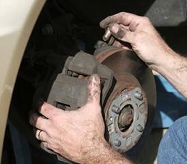 Man adjusting brake pads