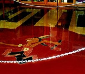 Du Quoin High School mascot Crazy Joe on gymnasium floor