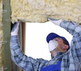 Man installing insulation