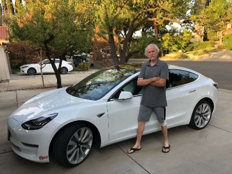 Jim Huff with his white Model S Tesla