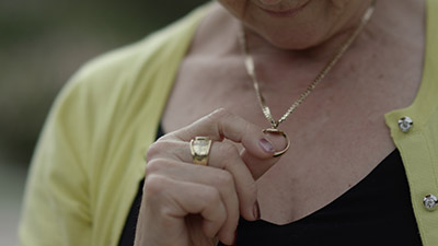 Lorraine Kember holding her wedding ring