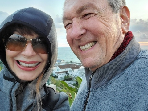 Maryla and Terry Latham take an outdoor selfie.