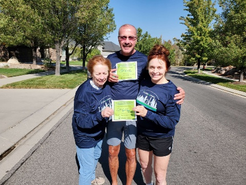 Three family members pose in Miles for Meso shirts