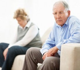 Older couple with man looking upset