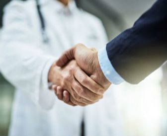 Doctor shaking the hand of a businessman
