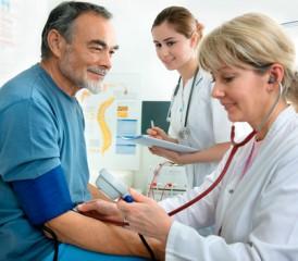 Female doctor treating an older man