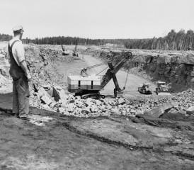 Worker overlooking pit