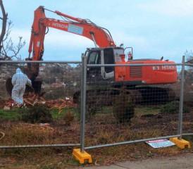Tractor removing asbestos contamination