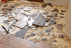 Broken floor tiles during a home remodel
