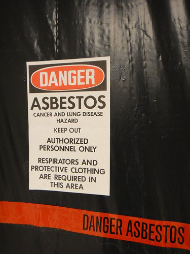 Asbestos warning sign at a jobsite.