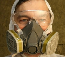Man wearing goggles and a respirator mask