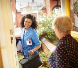 An at-home nurse visits a patient