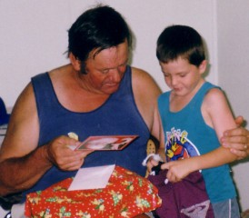 Brian Kember and his grandson Kam at Christmas
