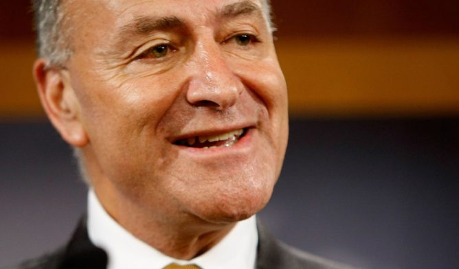 U.S. Sen. Charles Schumer of New York stands against FACT Act