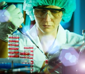 Female researcher with samples in vials