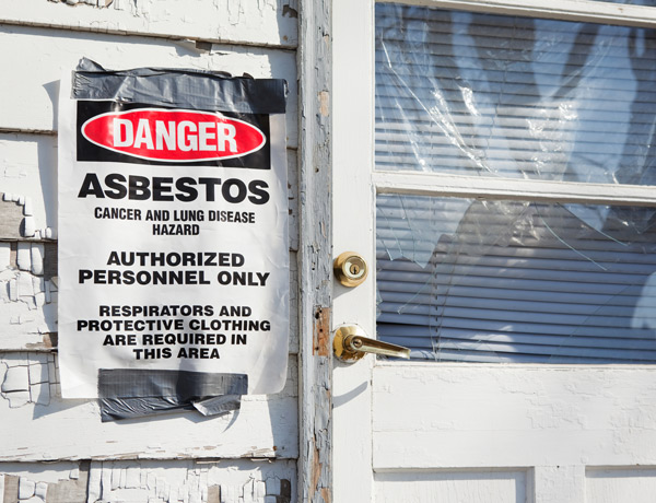 Condemned home with asbestos warning